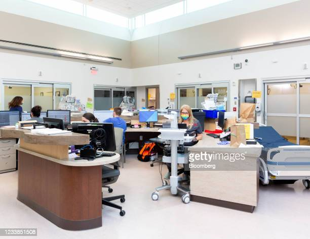 Healthcare workers in the emergency room at Cox Medical Center South in Springfield, Missouri, U.S., on Monday, June 28, 2021. President Biden set a...