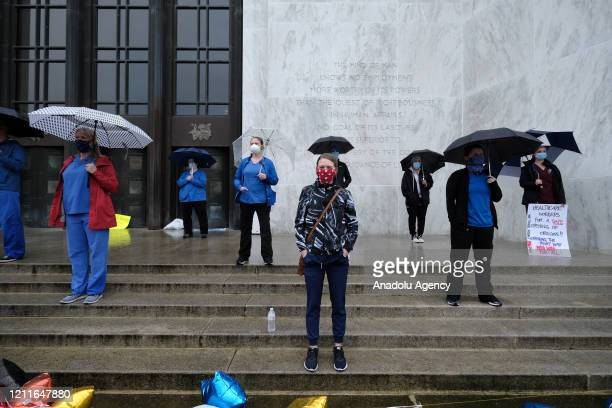 Healthcare workers join protesters at the ReOpen Oregon Rally on May 2 2020 in Salem Oregon United States Demonstrators gathered at the state capitol...