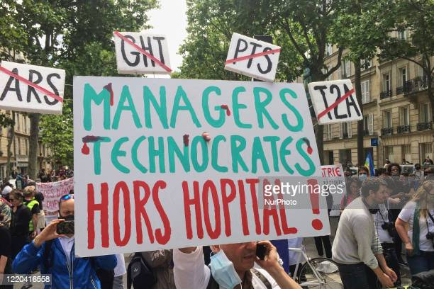 Healthcare workers take part in a demonstration at the call of the CGT SUD FO trade unions in front of the Ministry of Solidarity and Health in...