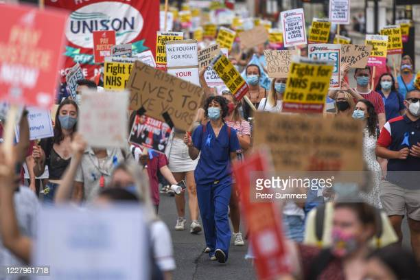 Healthcare workers take part in a protest over pay conditions in the NHS on August 8, 2020 in London, United Kingdom. NHS staff across the UK are...