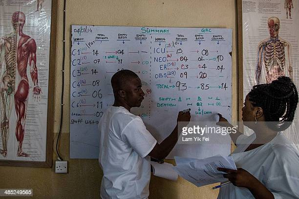 Healthcare workers update the latest figures of patients and deaths in Lassa islation ward at Gondama Referral Centre on March 4 2014 in Bo district...