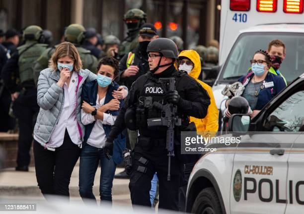 Healthcare workers walk out of a King Sooper's Grocery store after a gunman opened fire on March 22, 2021 in Boulder, Colorado. Dozens of police...