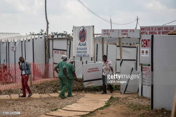 Healthcare workers walk outside the Ebola treatment centre in Beni eastern Democratic Republic of the Congo The DRC is currently experiencing the...