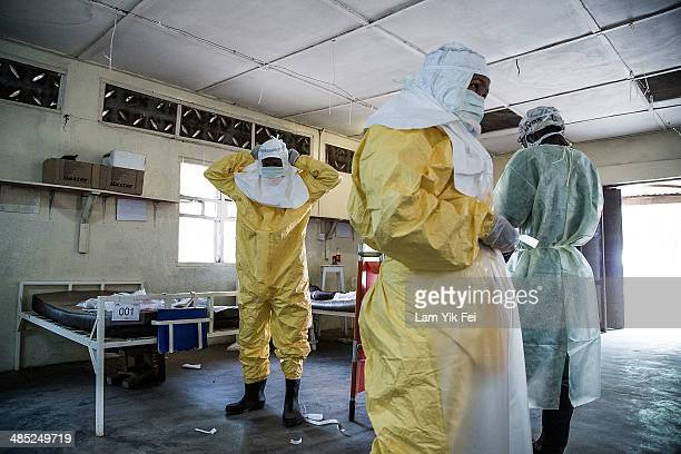 Healthcare workers wear protective equipment as they work at Lassa isolation ward at Gondama Referral Centre on March 3 2014 in Bo district Sierra...