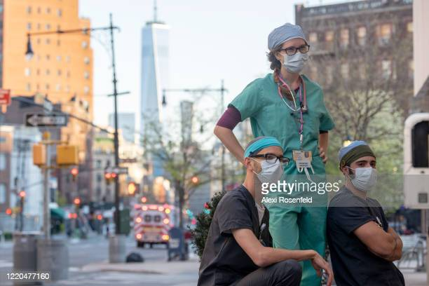 Healthcare workers wearing masks from the Lenox Health Greenwich Village Hospital pose together with the Freedom Tower in the background amid the...