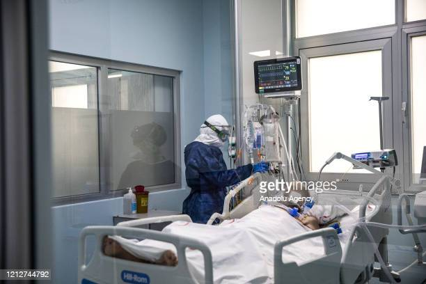 Healthcare workers wearing protective equipments to minimize the infection risk are seen during their shift at the intensive care unit of the Martyr...