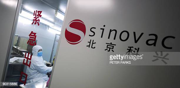 Health-flu-China-company-Sinovac-vaccine by Francois Bougon A lab technician is seen working at Chinese biotech firm Sinovac in Beijing on August 24,...