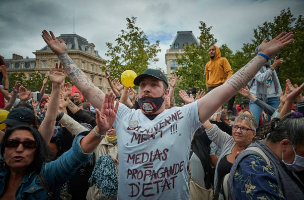 FRA: Anti-Government Protests In Paris On Bastille Day