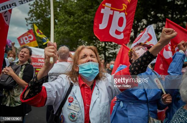 Healthworkers and members of the CGT Union chant against the President and his government during an Anti Government protest on Bastille Day near...