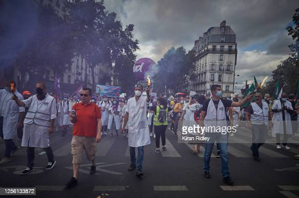 Healthworkers and members of the Sud Union demonstrate against the President and his government during an Anti Government rally on Bastille Day at...