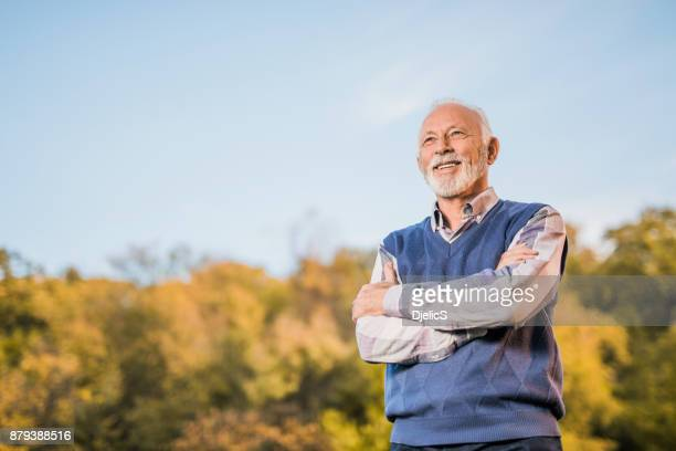Healthy and active senior man standing in the park.