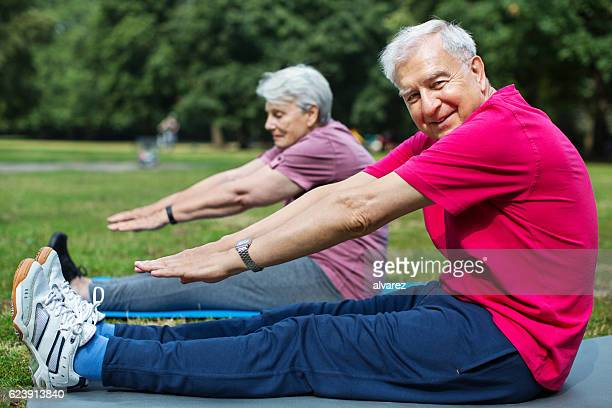 Healthy and active seniors doing fitness workout at park