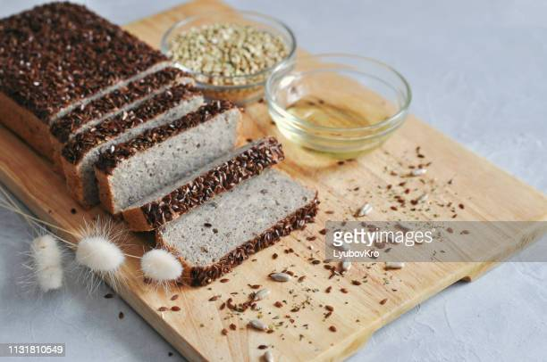 healthy and proper breakfast. homemade bread on sourdough of green buckwheat with flax seeds, sunflower. raw and vegan food. - buckwheat stock pictures, royalty-free photos & images