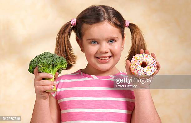 healthy and unhealthy eating choice - fat people eating donuts stock pictures, royalty-free photos & images