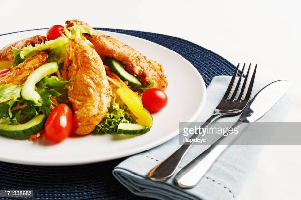 Healthy, balanced light meal of chicken and salad