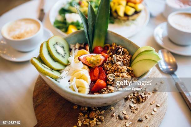 Healthy breakfast - acai smoothie bowl with fresh fruits