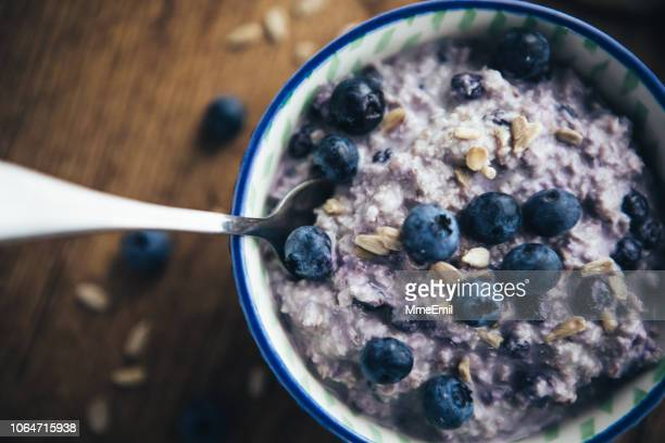healthy breakfast, blueberry overnight oatmeal - oats food stock pictures, royalty-free photos & images
