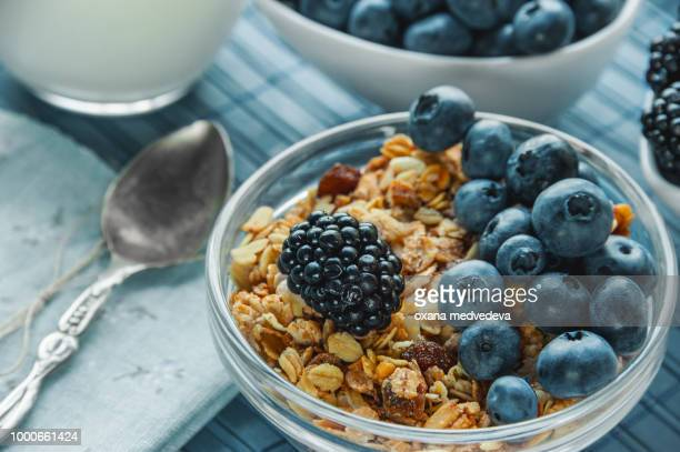 Healthy Breakfast cereals: muesli with fruits and berries blueberries, blackberries and dairy...