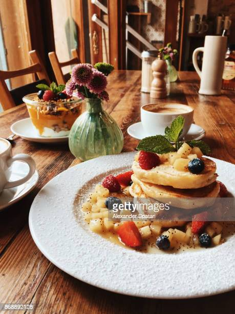 Healthy breakfast for two persons with pancakes and yoghurt