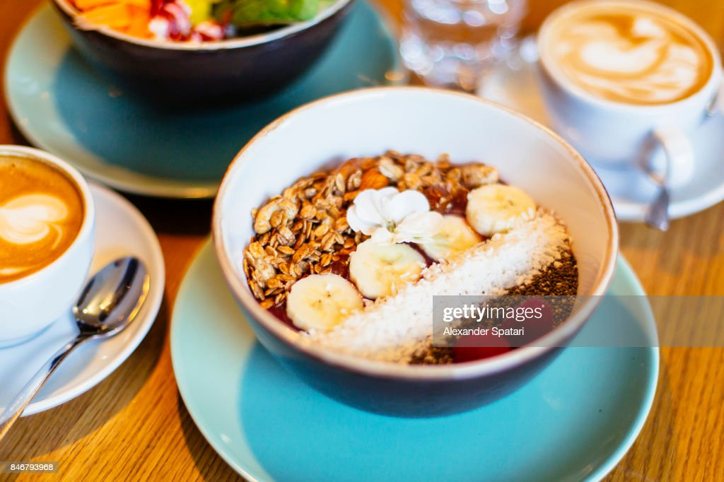 Healthy breakfast in a bowl with acai, fresh fruits, nuts and cereal in it : Stock Photo
