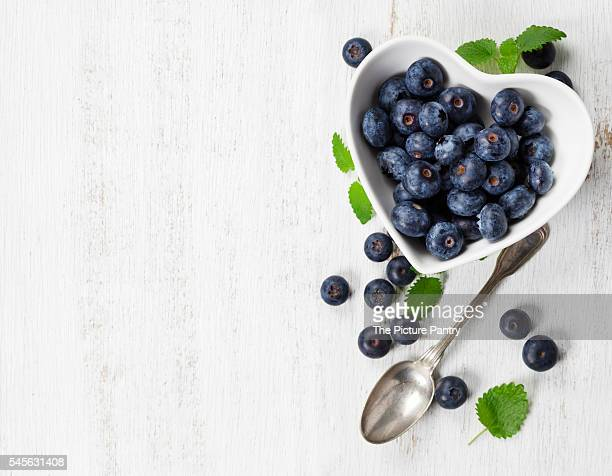 Healthy breakfast of blueberries on white background