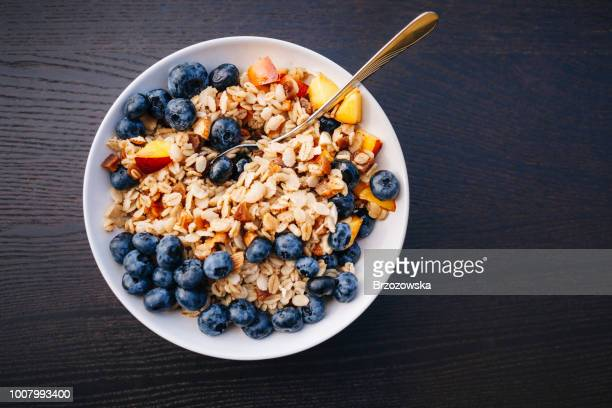 healthy breakfast - organic porridge with fruits - bowl stock pictures, royalty-free photos & images