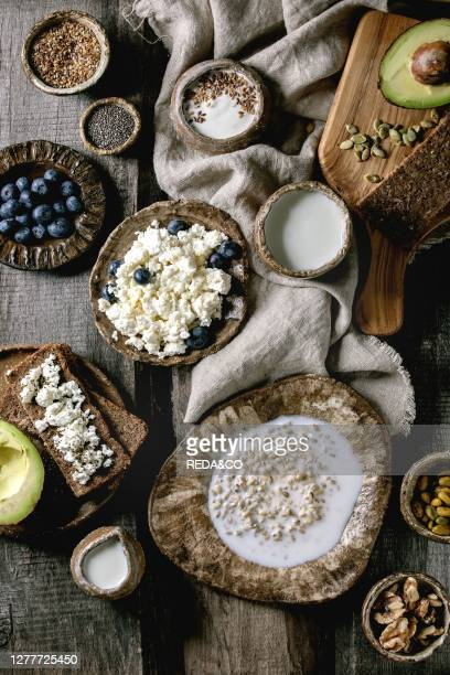 Healthy breakfast. Variety of breakfast dishes sprouted wheat. Yogurt. Kefir. Cottage cheese. Avocado. Rye bread. Seeds. Nuts and berries assortment...