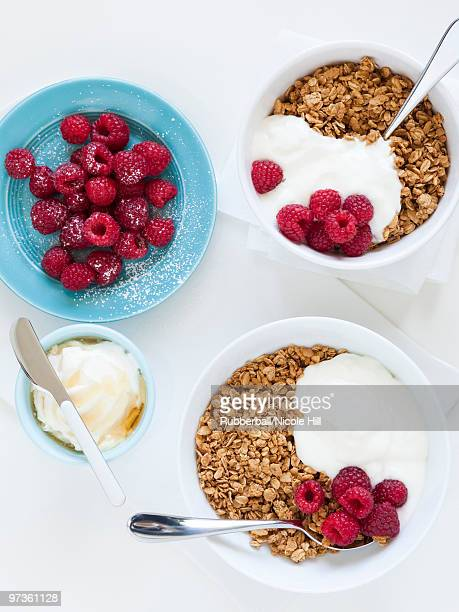 Healthy breakfast with cereals and fresh raspberries, studio shot