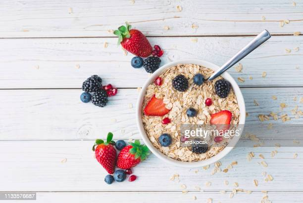 healthy breakfast with muesli and berries - cereal plant stock pictures, royalty-free photos & images