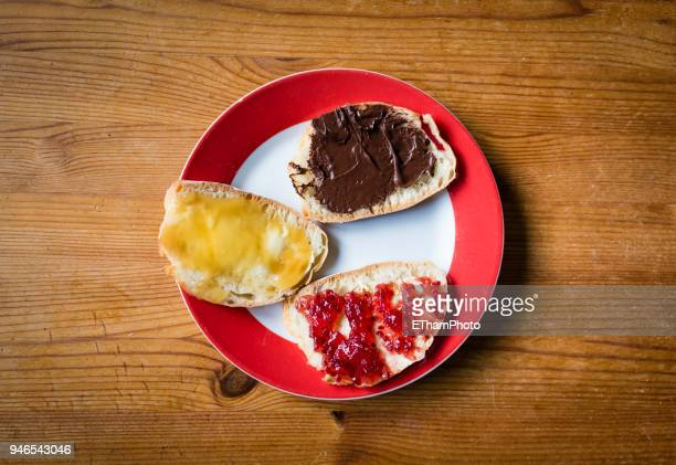 Healthy breakfast with slices of bread with marmalade, honey and hazelnut spread