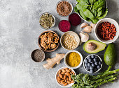 Healthy clean food - vegetables, fruits, nuts, superfoods on a gray background. Healthy eating concept. Top view.