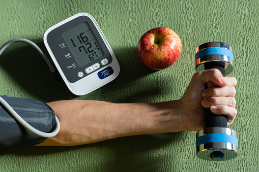 Healthy concept. Exercise and healthy eating are the causes of normal blood pressure. 1164990341