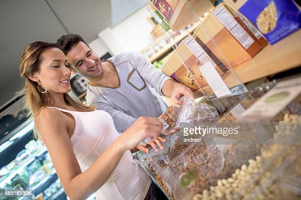 Healthy couple buying cereals at the market