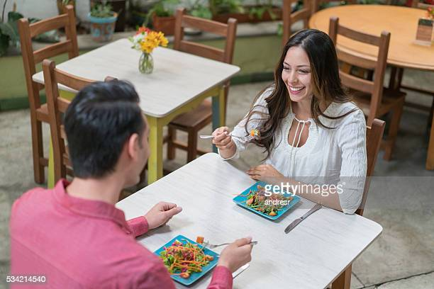 Healthy couple eating at a restaurant