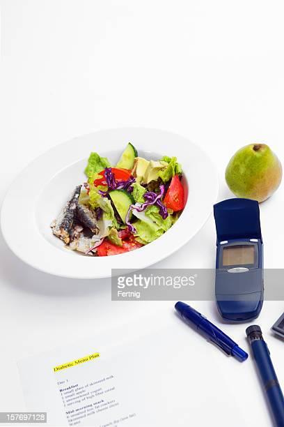 Gesunde Diabetische Mahlzeit und blood sugar-tester