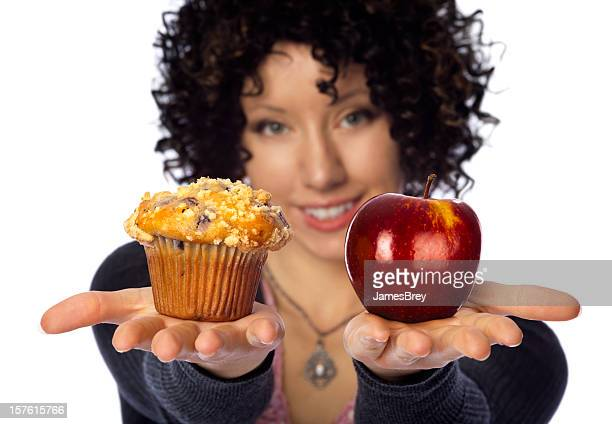 Healthy Diet Choices; Woman Holding Muffin VS Apple in Hands