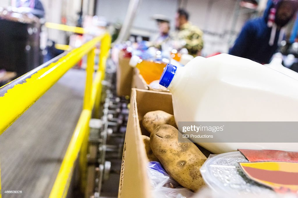 Healthy donated groceries in boxes at food bank warehouse : Stock Photo