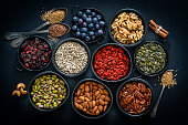 Healthy eating: assortment of nuts, seeds and fruits. Top view.