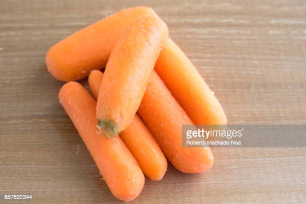 Healthy eating: Baby carrots over a wooden background