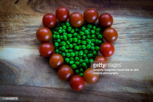 healthy eating - cherry tomatoes and green peas - gregoria gregoriou crowe fine art and creative photography. stock pictures, royalty-free photos & images