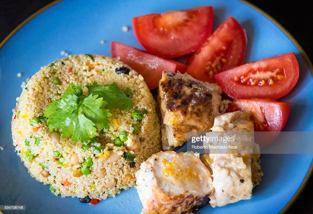 Healthy Eating: Chicken,Tomato Salad and Quinoa as Side Dish : Stock Photo