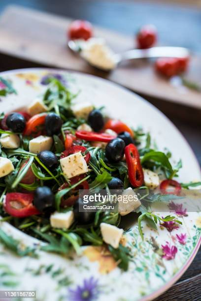 healthy eating concept - mixed mediterranean salad ingredients served in a rustic style - greek food stock pictures, royalty-free photos & images