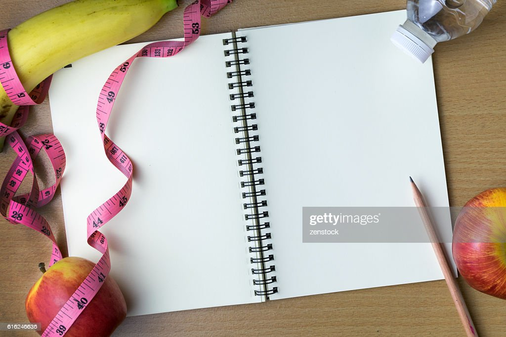 Healthy eating concept, tape measure, fruit and water bottle on : Foto de stock