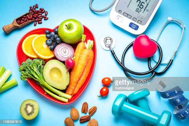 healthy eating, exercising, weight and blood pressure control - comida e bebida imagens e fotografias de stock