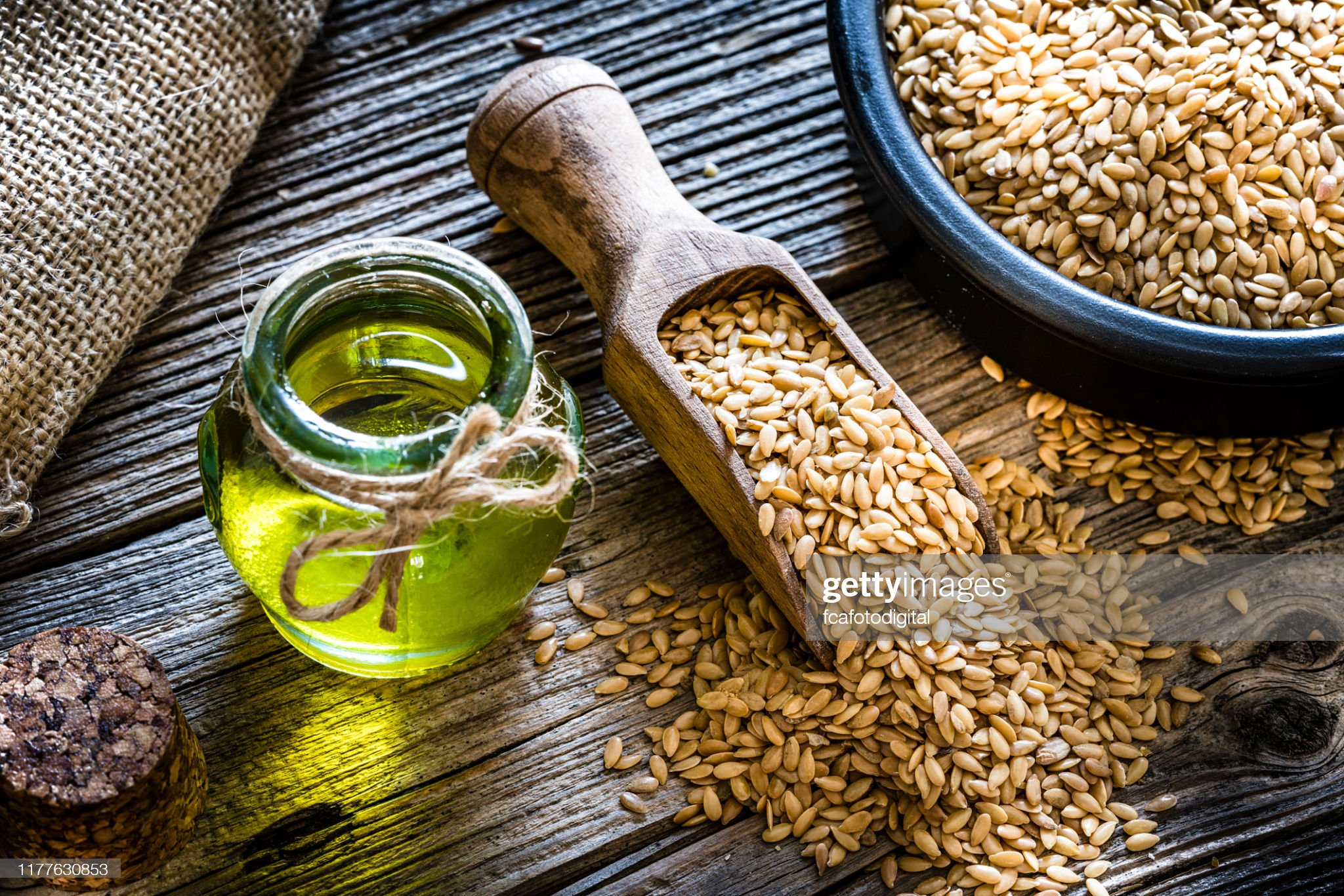 Healthy eating: Ffax seed oil and flax seeds : Stock Photo