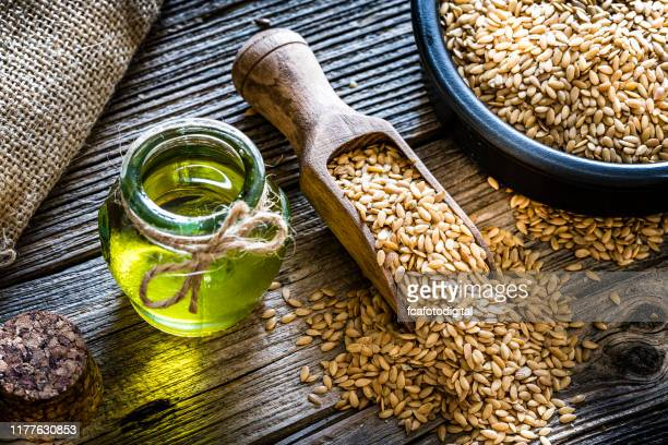 healthy eating: ffax seed oil and flax seeds - flax seed stock pictures, royalty-free photos & images