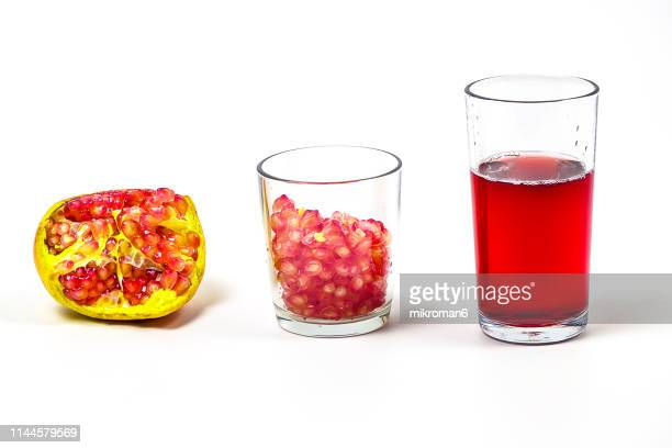 Healthy eating, fresh pomegranate fruit and juice