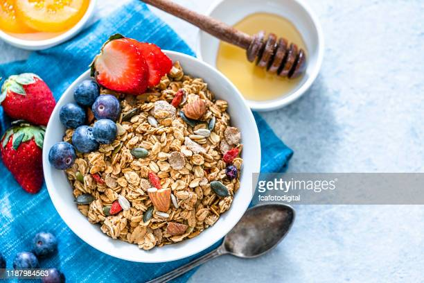 healthy eating: granola bowl with fruits for breakfast. top view with copy space - granola stock pictures, royalty-free photos & images