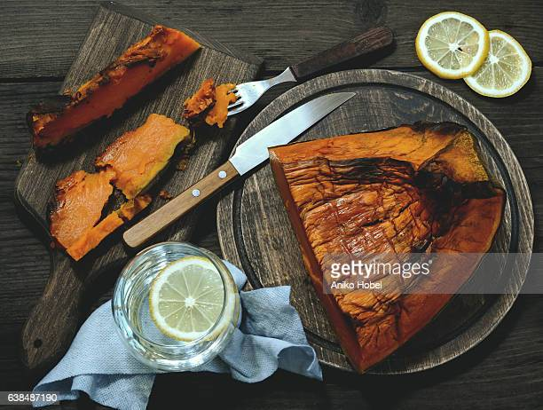 healthy eating, oven baked pumpkin - aniko hobel stock pictures, royalty-free photos & images