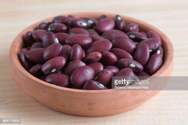 Healthy Eating: Red Kidney Beans. Raw food ingredient over a cutting board in kitchen